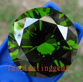 100.85CT STUNNING DEEP GREEN ROUND ZIRCON