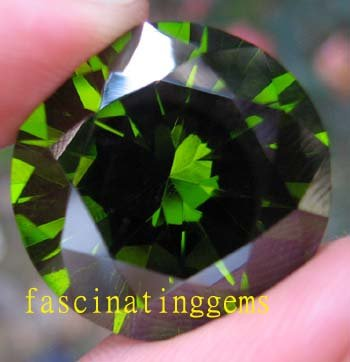208.00CT STUNNING DEEP GREEN ROUND ZIRCON