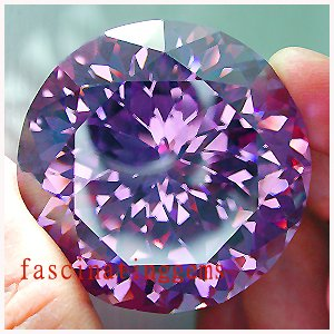 48.05CT BEAUTIFUL GLISTENING ROUND PURPLE ZIRCON