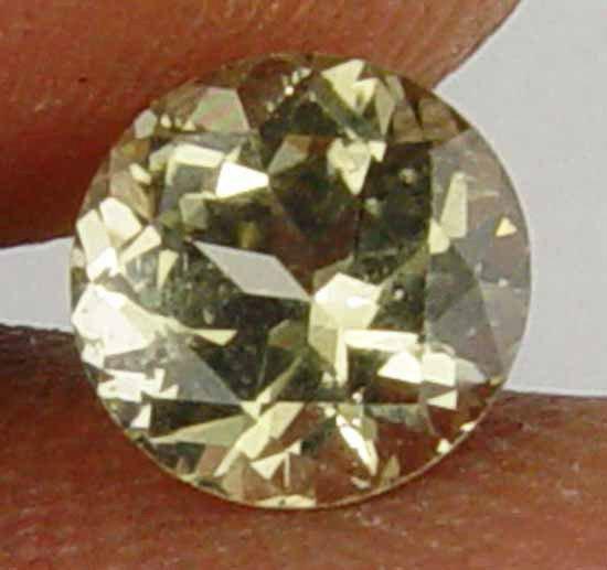 1.05CT Rare Round Cut Super Glow  Kornerupine 10090110