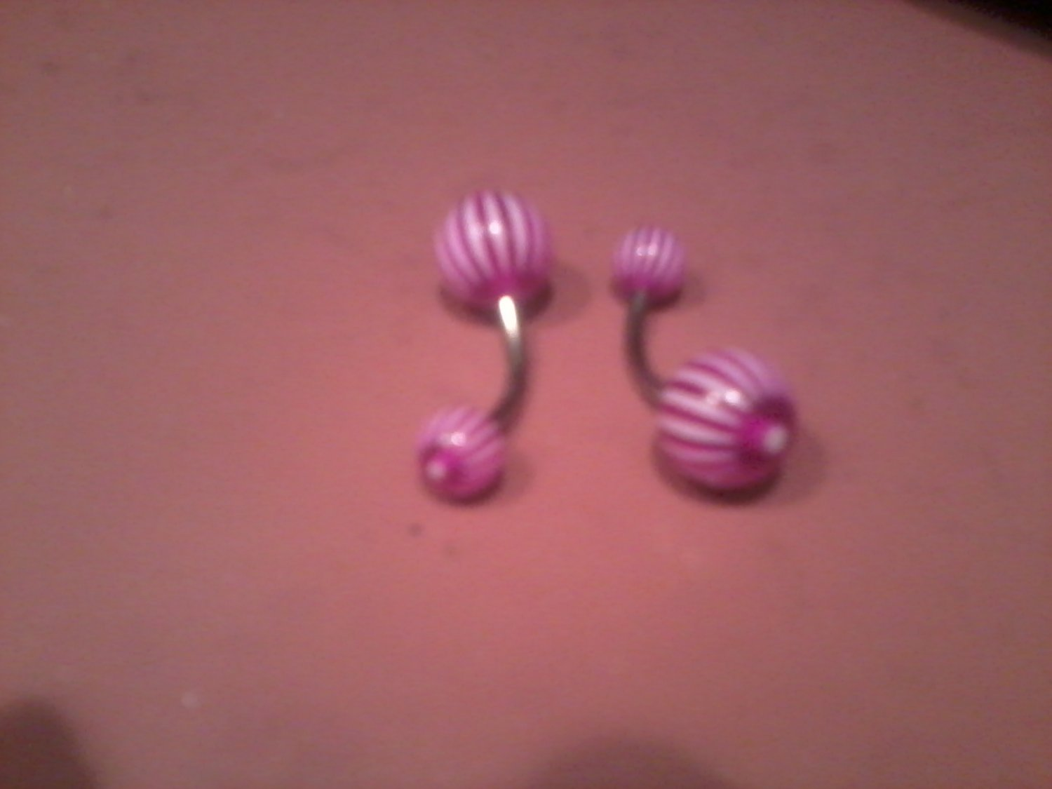 purple and white candy stripped belly button