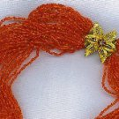 REMARKABLE 24 STRAND RED BEAD TORSADE NECKLACE