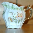 DELICATE CHINA PITCHER WITH PAINTED FLOWERS