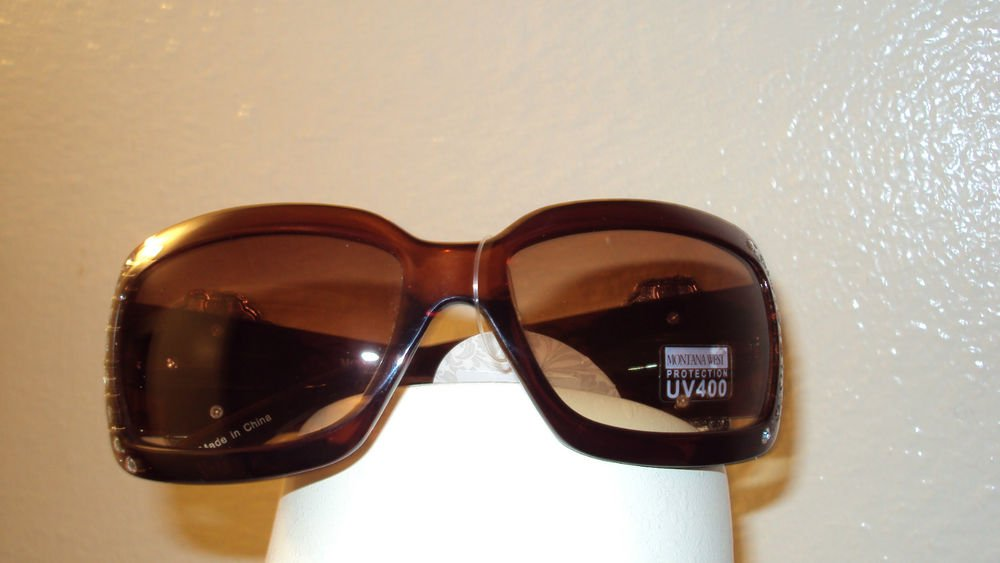 MONTANA WEST COWGIRL SUN GLASSES WITH A TURQUOISE CONCHO CROSS ON THE SIDE ARMS