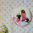 Round hand mirror (flower girl back)