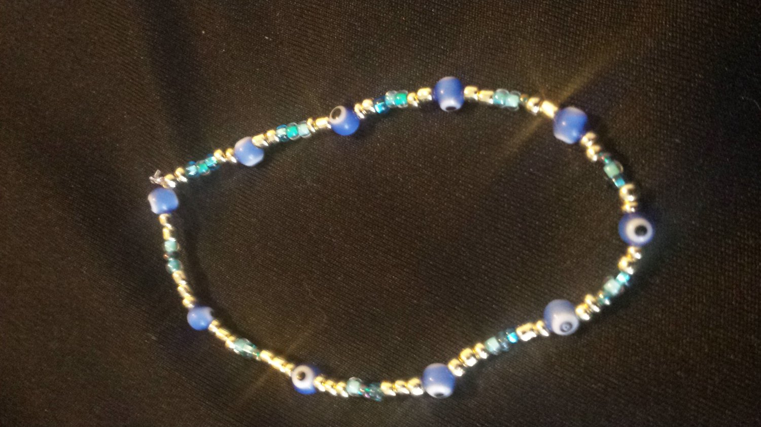 Simulated Gold Evil Eye Bracelet with Turquoise and Blue Accent Beads