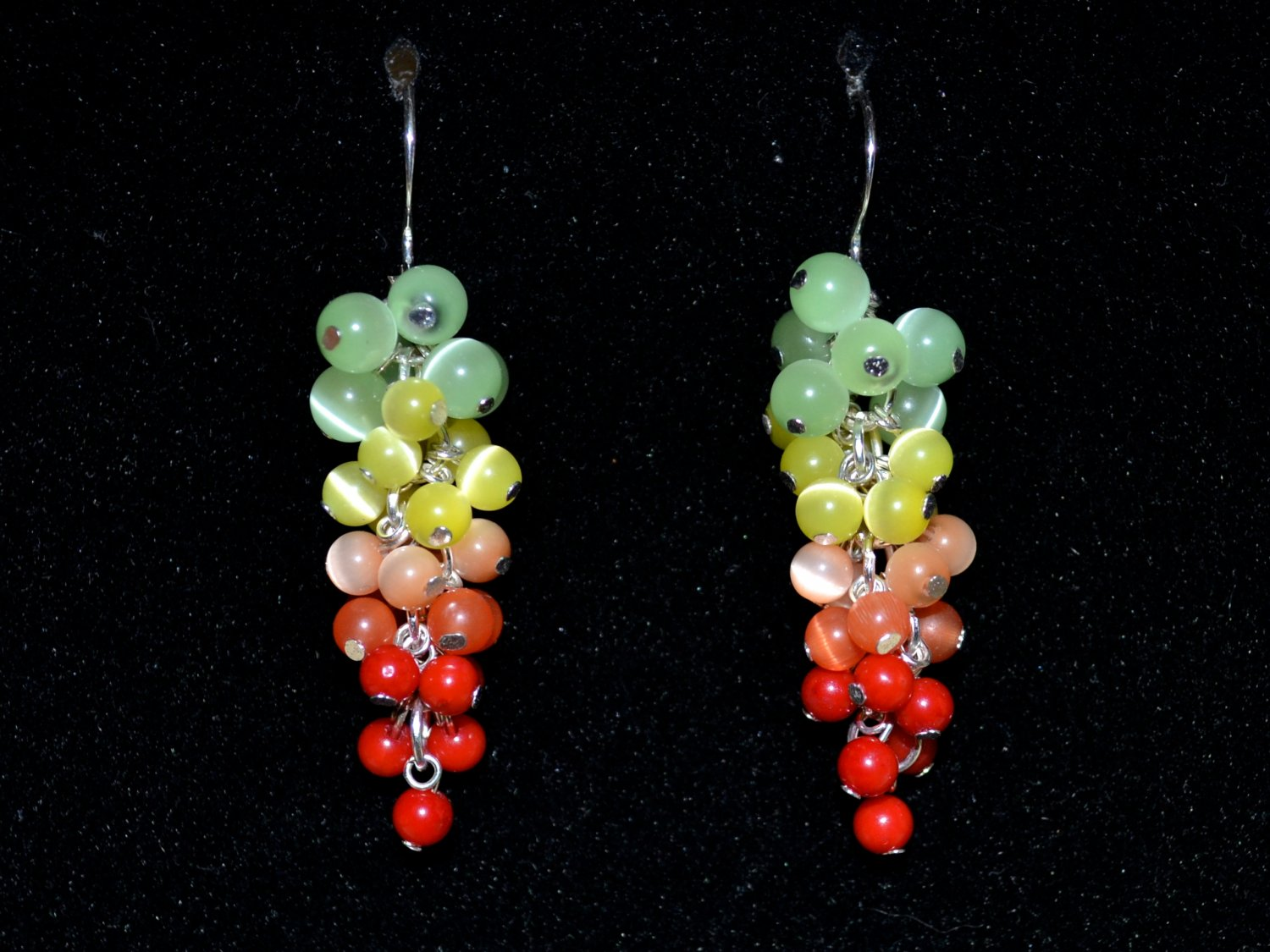 Earrings with cat's-eye and coral dangle from silver earwires