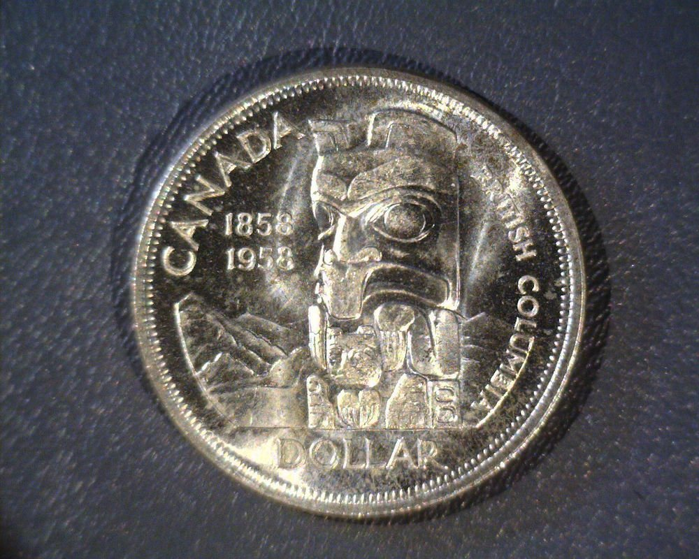 1958 Canada  Silver Dollar UNC KM#55   .600 ASW Totem Pole Nice Luster !