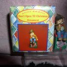 Little Emmett Kelly Jr. circus clown  sitting on  Package ornament