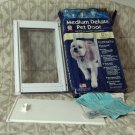 IDEAL PET PRODUCTS Deluxe Medium Dog Doggie Door Unused