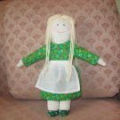 Doll with light green dress and apron