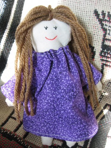 Miniature Doll in Purple Dress