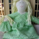 Handcrafted doll in light green dress