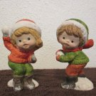 Boy and Girl throwing snowballs figurines pair