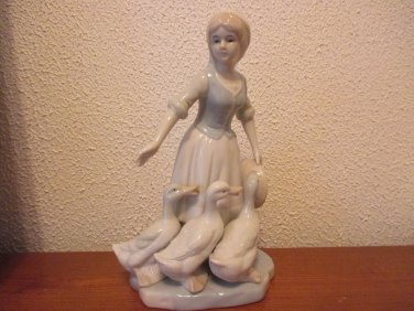 Vintage Porcelain Woman with ducks figurine