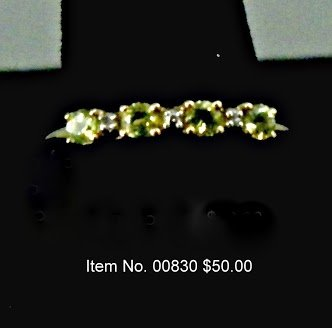 Item No. 00830Peridot & Diamond Ring: in10K yellow gold setting  Setting