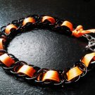 Black Chainmaille Bracelet with Orange Accent Ribbon