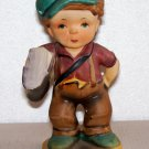 Hummel type of figurine made in Japan paperboy marked M6503 crossed arrows