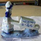 Made in Japan Holland Blue Deflt type of figure pushing a wheelbarrow