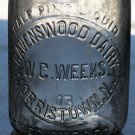 W.C. Weeks Ravenswood Dairy Morristown, N.J. half pint clear bottle empty