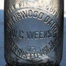 W.C. Weeks Ravenswood Dairy Morristown, N.J. half pint clear bottle empty