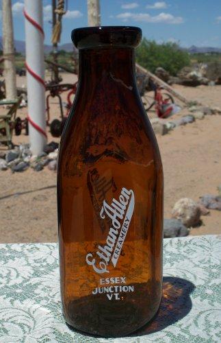 Ethan Allen Creamery Essex Junction, VT. empty brown amber colored quart bottle