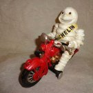 Cast Iron Michelin Man on Motorcycle