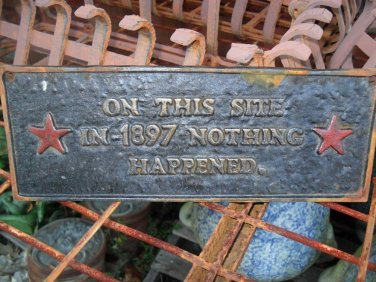 """Cast Iron Plaque """" On This Site in 1897  Noting Happened"""""""