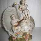 Dresden Winged Cherub Instrumental Shell Figurine