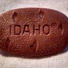 "IDAHO Potato LAPEL PIN -Plastic Potato Gem State Garnets ""Idahoans"""