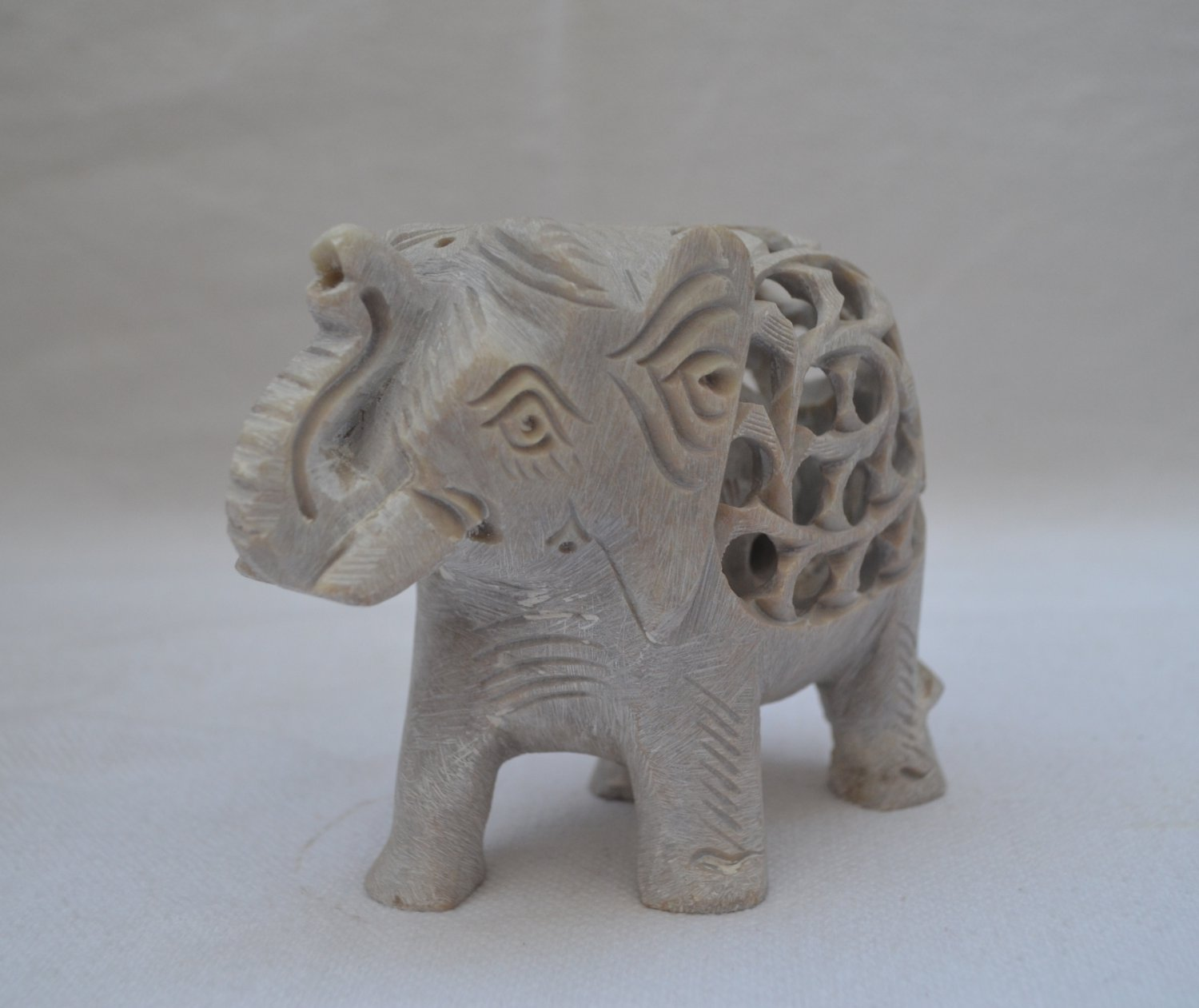 Marble Blocks For Sculpting : Antique carving on a marble block with elephant within