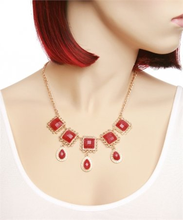 Beautiful gold tone necklace with square stones over teardrop stones jewelry
