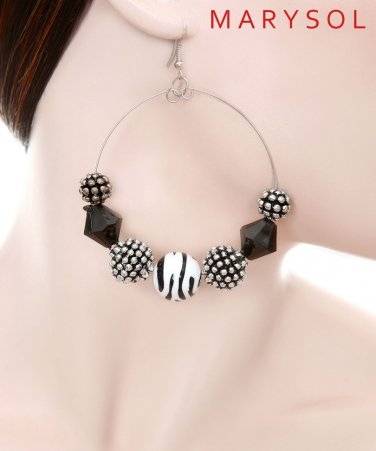 1 pair of medium hoop earrings with black, silver and zebra print beads
