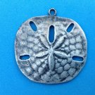 "VINTAGE PEWTER SAND DOLLAR PENDANT @ 1 3/8"" IN DIAMETER - NEEDS LOOP"