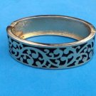 BEAUTIFUL RAISED GOLD TONE DESIGN & BLACK BACKGROUND HINGED BANGLE BRACELET 7.5""