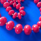 "VINTAGE RED PLASTIC BEADS WITH SMALL GOLD TONE SPACER BEADS NECKLACE 24"" LONG"