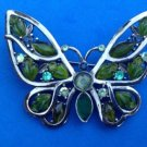"PRETTY GREEN AND BLUE STONE SET IN BLACK METAL BUTTERFLY PIN 3"" X 2 1/4"""
