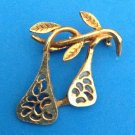 "GOLD TONE PIN OF HANGING FRUIT WITH A STYLIZED CUT OUT DESIGN @ 1 1/2"" X 1 1/2"""