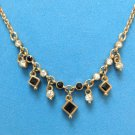 PRETTY GOLD TONE WITH DANGLING BLACK & RHINESTONE  PIECES NECKLACE