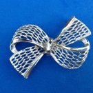 "LOVELY LARGE PIERCED SILVER TONE BOW PIN 2.5"" X 1.5"""