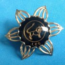"VINTAGE HOROSCOPE LEO LION BLACK AND GOLD TONE PIN 1 1/2"" IN DIAMETER"