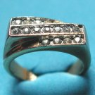 3 ROWS OF CLEAR STONES IN A  GOLD THICK BAND RING - SIZE 5 1/4 COSTUME