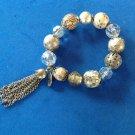 "Stretch beaded bracelet gold tones & dangle, 5/8"" diameter stones."