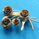 "Roses, gold tone pin, vintage boquet of 4 textured roses @ 2"" x 1 1/4""."