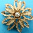 "Gold pin pearl center, flower, 1 3/4"" in diameter."