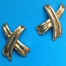 "Pierced earrings, gold tone stylized ""x"", 1 1/4"" x 7/8""."