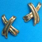 """Pierced earrings, gold tone stylized """"x"""", 1 1/4"""" x 7/8""""."""