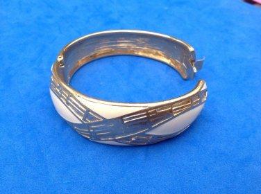"Crown Trifari bangle bracelet. Hinged, cream enamel. Gold tone -  7/8"" x 6.5""."