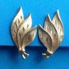 "Clip earrings, gold tone, vintage, shiny & satin  1 1/4"" x 3/4""."