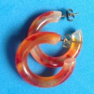 "Plastic hoop pierced earrings. Vintage, orange swirl & clear  1"" x 3/8"" lightweight."